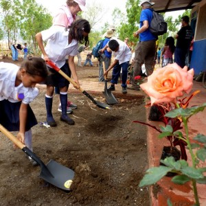 Pedro Arauz students plant flowers outside the school